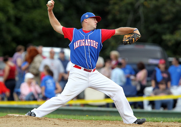 John Cahill throws a strike while pitching for the NS Old Timers against the Peabody Police Department, during the 56th Annual Labor Day Game. David Le/Staff Photo