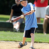 NS Old Timers bat boy and pinch hitter Cade Buckley, 9, makes contact for a base hit during the 56th Annual Peabody Police vs. NS Old Timers game. David Le/Staff Photo
