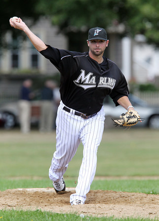 Former Major League pitcher for the Florida Marlins, and Peabody High School star Jeff Allison throws a pitch during the 56th Annual Peabody Police vs. NS Old Timers game on Labor Day Monday. David Le/Staff Photo