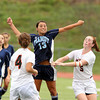 Peabody striker Victoria Digiacomo, center, wins a header in between Beverly's Becca Kemmer, left, and Sarah Visnick, right, on Saturday morning. David Le/Staff Photo