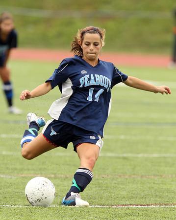 Peabody senior captain Kara Digiacomo takes a shot on net against Beverly on Saturday morning. David Le/Staff Photo