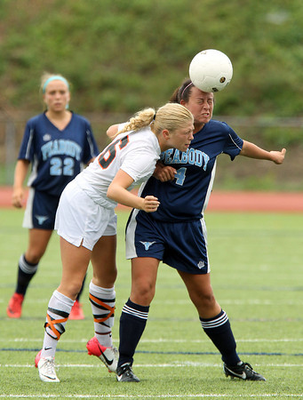 Beverly midfielder Eva Gourdeau, left, and Peabody fullback Nicole Napolitano, right, battle for a header during the second half of play on Saturday morning. Peabody senior captain Victoria Digiacomo tucked away a penalty kick to give the Tanners a 1-0 victory. David Le/Staff Photo
