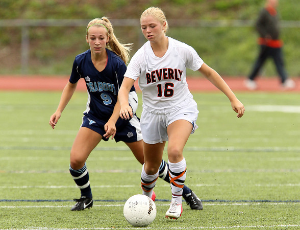 Beverly sophomore midfielder Eva Gourdeau controls the ball while Peabody midfielder Christa Trombley tries to contain her on Saturday morning. David Le/Staff Photo