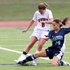 Peabody senior captain Kara Digiacomo slides in to try and win the ball from Beverly senior Allison Collins on Saturday morning. David Le/Staff Photo