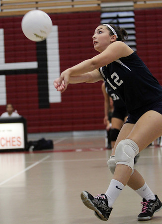 Peabody outside hitter Jillian DiFelice concentrates on returning a serve against Salem on Thursday afternoon. David Le/Staff Photo