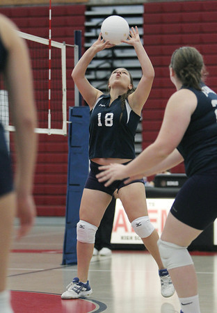 Peabody High School outside hitter Kathryn Gallo passes the ball to a teammate against Salem on Thursday afternoon. David Le/Staff Photo