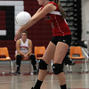 Salem High School junior libero Hannah Mularkey digs a serve against Peabody on Thursday afternoon. David Le/Staff Photo
