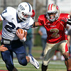 St. John's Prep senior wide receiver Alex Moore, left, tries to evade the tackle from Everett senior Jakarrie Washington, right, on Saturday afternoon. The top two ranked teams in the state clashed on the gridiron at Everett Memorial Stadium and Everett prevailed 19-7. David Le/Staff Photo