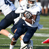 St. John's Prep junior Michael Fawehinmi spins and looks upfield after picking off an errant pass from Everett quarterback Gilly DeSouza. Despite the Eagles' best efforts they fell short, falling to the Crimson Tide 19-7. David Le/Staff Photo