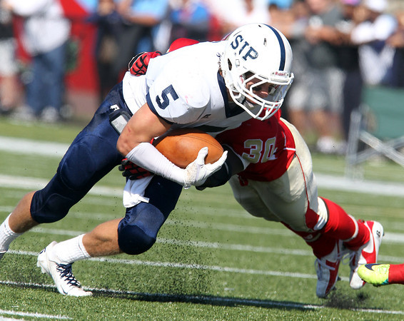 St. John's Prep senior receiver Lucas Bavaro, left, tries to fight through a tackle from Everett's CJ Parvelus on Saturday afternoon. David Le/Staff Photo