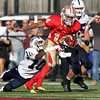 St. John's Prep senior Gerald Kahari, left, drags down Everett quarterback Gilly DeSouza, right, on Saturday afternoon. Top ranked Everett toppled second ranked St. John's 19-7 in a tightly contested game at Everett Memorial Stadium. David Le/Staff Photo