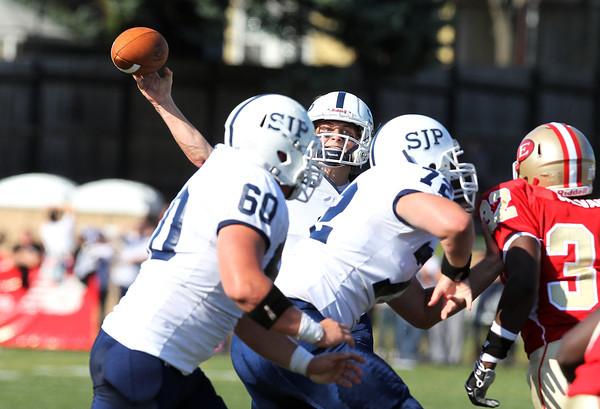St. John's Prep senior quarterback Jack Sharrio looks to pass against Everett on Saturday afternoon. The Eagles and Crimson Tide battled all afternoon in a close contest that Everett ended up winning 19-7. David Le/Staff Photo