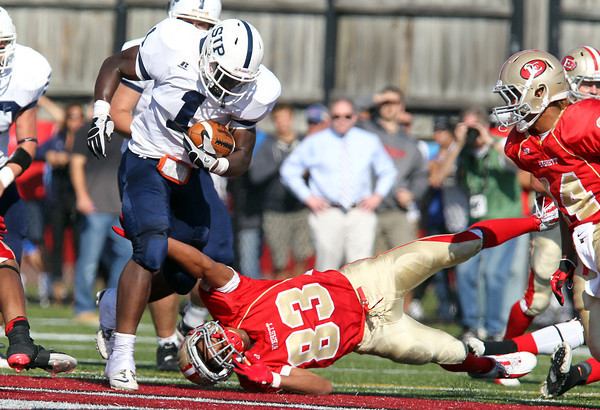 St. John's Prep junior running back Johnny Thomas, left, breaks an arm tackle from Everett's Omar Graciano on Saturday afternoon. Thomas carried the ball 19 times for 101 yards yet the Crimson Tide were too much for the Eagles and defeated them 19-7. David Le/Staff Photo