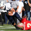St. John's Prep senior captain Alex Moore can't escape the tackle of Everett senior Jakarrie Washington on a short pass on Saturday afternoon. The top two ranked teams in Massachusetts squared off for a showdown at Everett Memorial Stadium and the Crimson Tide prevailed 19-7. David Le/Staff Photo