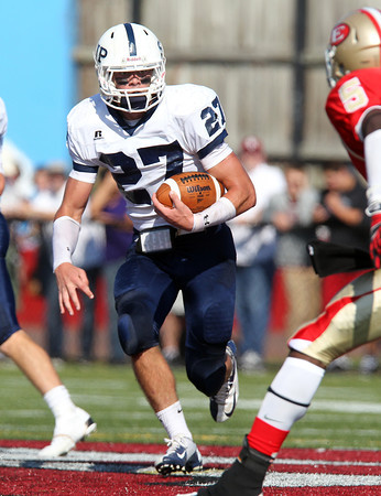 St. John's Prep senior captain Alex Moore looks for running room against Everett on Saturday afternoon in a clash of the top two ranked teams in Massachusetts. Despite Moore and the Eagles' best efforts Everett continued their winning streak and downed the Eagles 19-7. David Le/Staff Photo