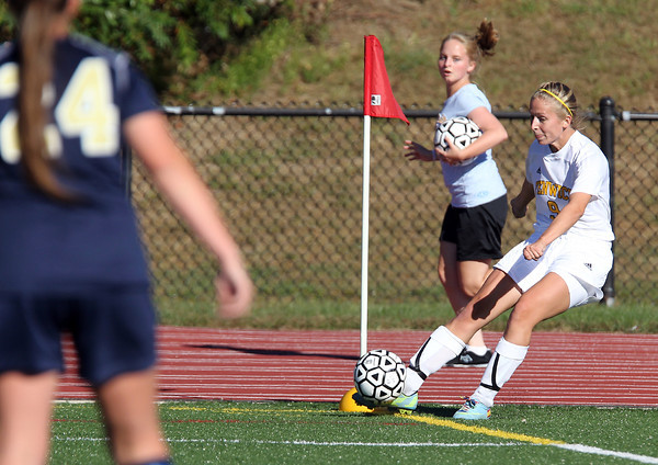 Bishop Fenwick senior Becky Mercuro lofts a corner kick into the box against St. Mary's of Lynn on Wednesday afternoon. David Le/Staff Photo