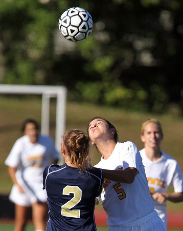 Bishop Fenwick junior Annette Ruggiero, right, and St. Mary's senior Victoria Viger, left, fight for a 50/50 ball during the first half of their game on Wednesday afternoon. David Le/Staff Photo