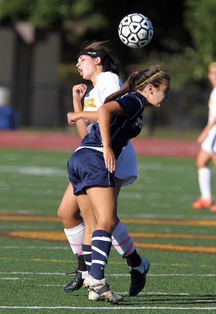 Bishop Fenwick sophomore Jennie Nasser, left, and St. Mary's junior Jacqueline Murphy, right, collide while battling for a header. David Le/Staff Photo