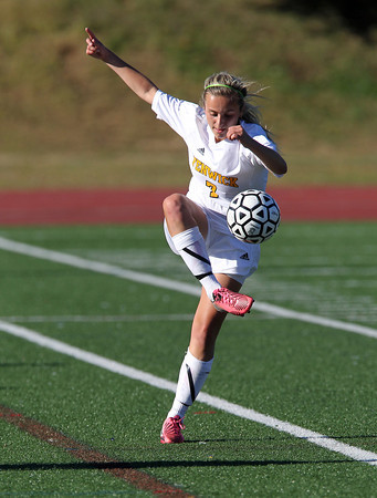 Bishop Fenwick senior Ali MacDonald controls a ball as it bounces up in the air while playing against St. Mary's of Lynn on Wednesday afternoon. David Le/Staff Photo