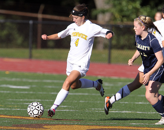 Bishop Fenwick sophomore Jackie Edgett, left, keeps her eyes on the ball while being pursued by St. Mary's junior Amanda Donahoe, right, on Wednesday afternoon. David Le/Staff Photo
