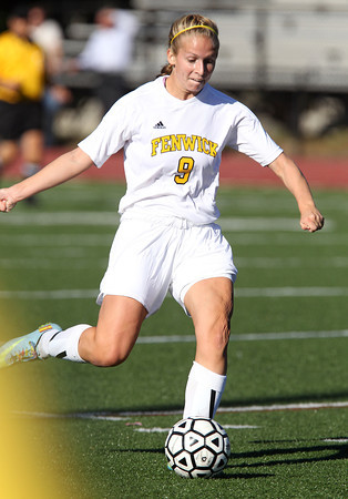 Bishop Fenwick senior midfielder Becky Mercuro winds up and takes a shot on net. David Le/Staff Photo