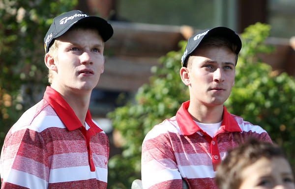 Salem High School senior captain Will Parr, right, and teammate senior Josh Lausier, left, follow the flight of a tee shot off the first hole at Olde Salem Greens against Lynn English on Thursday afternoon. Parr had his right leg amputated above his knee when he was younger only started playing golf as a freshman in high school. Now Parr captains the 2012 Witches squad and is their No. 3 player. David Le/Staff Photo