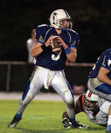 Danvers: Danvers junior quarterback Nick Andreas drops back to pass against Beverly on Friday evening. Andreas found senior running back Alex Valles for a 47-yard touchdown strike with 3:18 to play, giving the Falcons a 33-28 lead they would not give up. David Le/Salem News