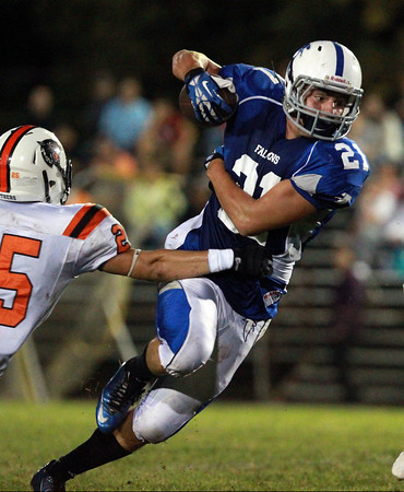 Danvers: Danvers senior running back Alex Valles makes a cut upfield against Beverly on Friday evening. Valles was a force for the Falcons rushing for 233 yards, with 4 total touchdowns, as the Falcons upset the Panthers 33-28 on Friday evening. David Le/Salem News