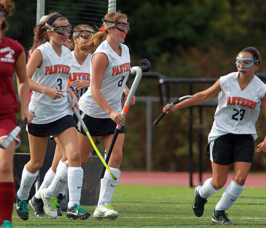 Beverly: Beverly senior Mary Cate Flaherty (8), center, gets congratulated by teammates Molly Pitman (3), left, and Alicia Cecchini (23), right, after scoring the first of her three goals on the afternoon. David Le/Salem News
