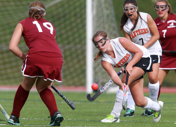 Beverly: Beverly senior Mary Cate Flaherty, right, makes a hard pass upfield that gets past Gloucester's Kate Morrissey. Flaherty led the way for the Panthers, scoring a hat trick in the first half of play, as the Panthers took down the Fishermen 7-0 on Monday afternoon. David Le/Salem News