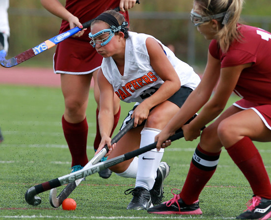 Beverly: Beverly's Alicia Cecchini (23), left, battles with Gloucester captain Liv Legendre, right, on Monday afternoon. David Le/Salem News