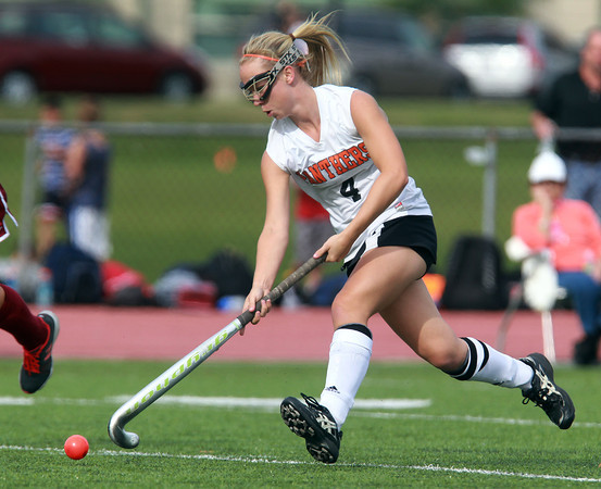 Beverly: Beverly senior captain Nicole Woods carries the ball upfield against Gloucester on Monday afternoon. David Le/Salem News