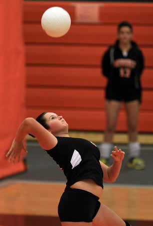 Beverly: Beverly's Ally Cabral leaps high in the air while serving against Masco on Monday afternoon. David Le/Salem News
