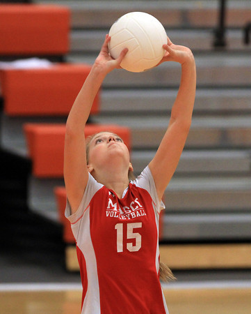 Beverly: Masco junior Katherine McManus lofts a pass across court to a teammate against Beverly in a non-league match on Monday afternoon. David Le/Salem News