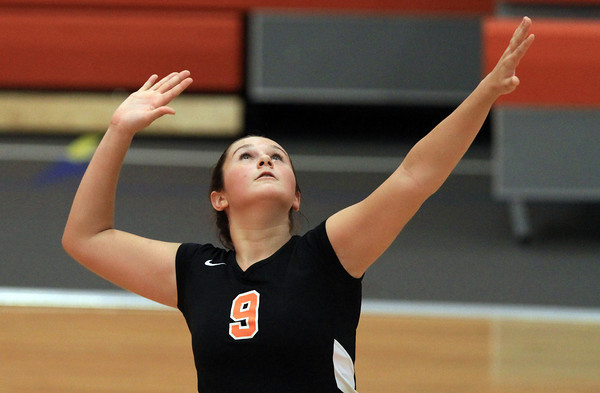 Beverly: Beverly's Ally Cabral concentrates as she rises up in the air for a spike on Monday afternoon against Masco. David Le/Salem News