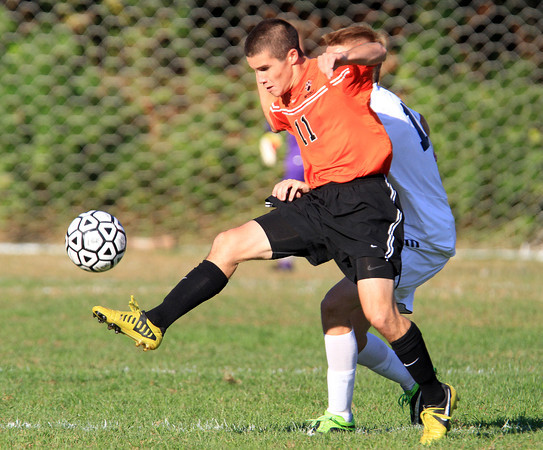 Salem: Beverly senior captain Ryan Santo controls the ball in the midfield while being pressured by a Salem player on Tuesday afternoon. David Le/Salem News