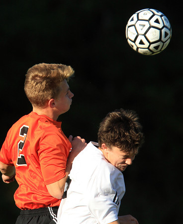 Salem: Beverly's Sean Curtin (2) left, and Salem's Eamon Williamson (16) right, battle for a header on Tuesday afternoon. David Le/Salem News