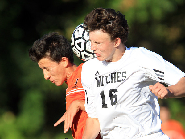 Salem: Salem's Eamon Williamson (16) right, battles for a header with Beverly's Elesio Kanani (1), left, on Tuesday afternoon. David Le/Salem News