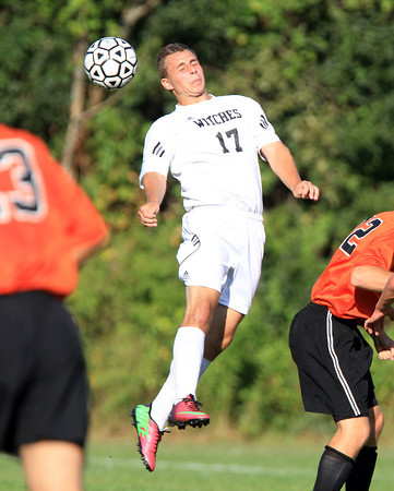 Salem: Salem's JT Kapnis leaps high in the air to win a header in midfield on Tuesday afternoon. David Le/Salem News