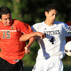 Salem: Beverly's John Loreti (15) left, and Salem's Gabriel Andreotolla (4) lock up as they fight for possession of the ball on Tuesday afternoon. David Le/Salem News