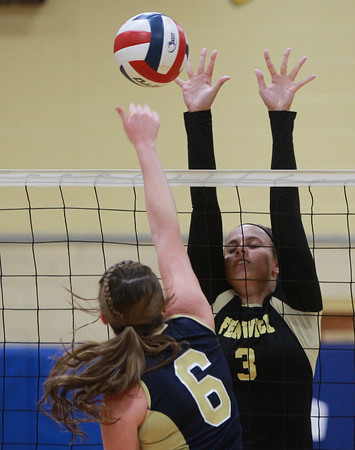 Peabody: Bishop Fenwick junior Madison Camelo, right, rises up and blocks a spike attempt from Archbishop Williams senior Maegan O'Leary, on Tuesday afternoon. David Le/Salem News