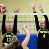 Peabody: Bishop Fenwick junior Alexis Bedard (12), and senior captain Kate Lipka (4) rise up and block a shot from an Archbishop Williams player on Tuesday afternoon. David Le/Salem News