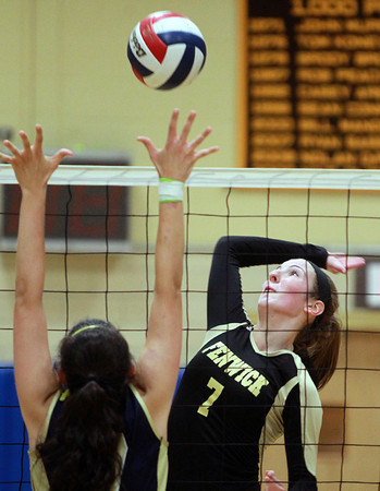 Peabody: Bishop Fenwick senior captain Jen Crovo leaps high in the air and smashes the ball past the outstretched arms of an Archbishop Williams player during the first match on Tuesday afternoon. David Le/Salem News