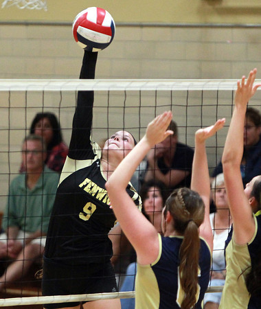 Peabody: Bishop Fenwick senior captain Gianna Pizzano leaps high in the air and smashes a spike over the net against Archbishop Williams on Tuesday afternoon. David Le/Salem News