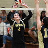Peabody: Bishop Fenwick senior captain Kate Lipka pushes the ball over the outstretched hands of Archbishop Williams senior Renee Patten and finds a hole in the Bishops defense for a Crusaders point in the third match of the afternoon. David Le/Salem News