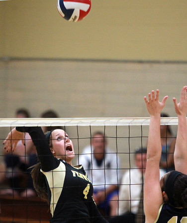 Peabody: Bishop Fenwick senior captain Kate Lipka leaps high in the air and smashes the ball past the outstretched arms of several Archbishop Williams defenders on Tuesday afternoon. David Le/Salem News