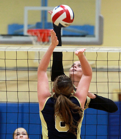 Peabody: Bishop Fenwick junior Madison Camelo spikes the ball past Archbishop Williams senior Maegan O'Leary for a Crusaders point on Tuesday afternoon. David Le/Salem News