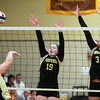 Peabody: Bishop Fenwick senior captain Tessa McLaughlin (19) and junior Madison Camelo (3) rise up and block a shot from Archbishop Williams junior Molly Plunkett, during the first match on Tuesday afternoon. David Le/Salem News