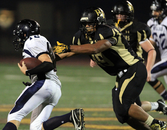 Peabody: Bishop Fenwick's Rufus Rushins chases down North Shore Tech's Matthew Almon on Friday evening. David Le/Salem News