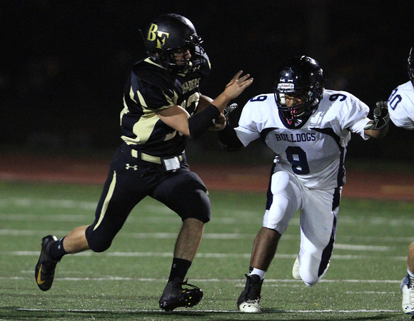 Peabody: Bishop Fenwick's Robert Carrillo bursts through the North Shore Tech defense for a 75 yard touchdown run on Friday evening. David Le/Salem News